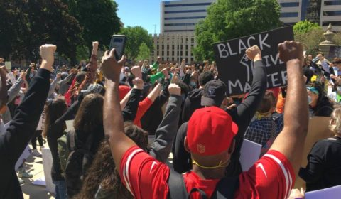 Image of Black Lives Matter protestors raising fists in solidarity.
